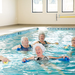 Residents doing water aerobics